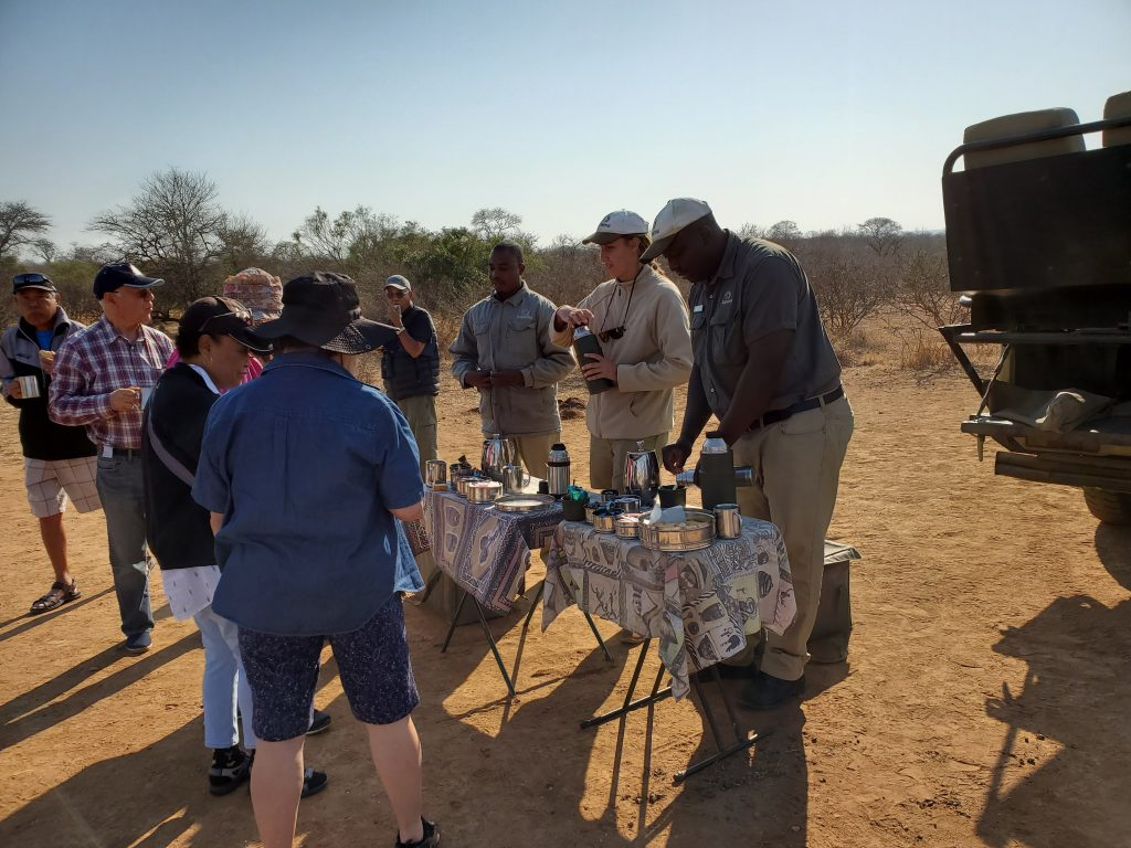 We were treated to biscuit and hot beverages. Amazingly, the hot drinks tasted so delicious even on a hot day in the safari.