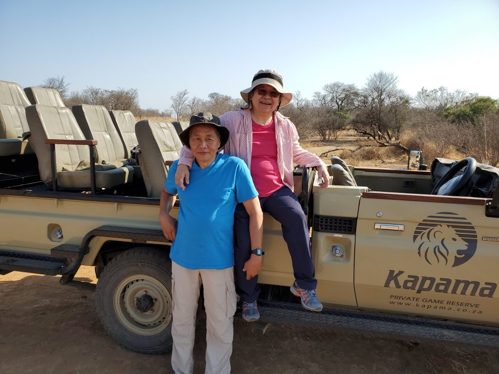 Peter and Susan next to the 4x4 vehicle on the Safari.