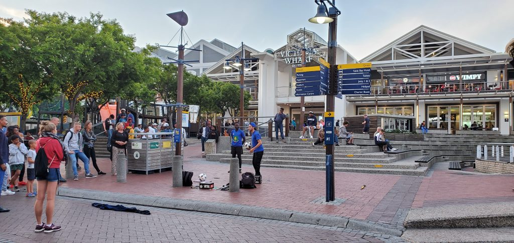 Street performers right outside the Shopping Center entrance