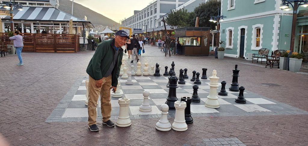 Peter trying to play chess