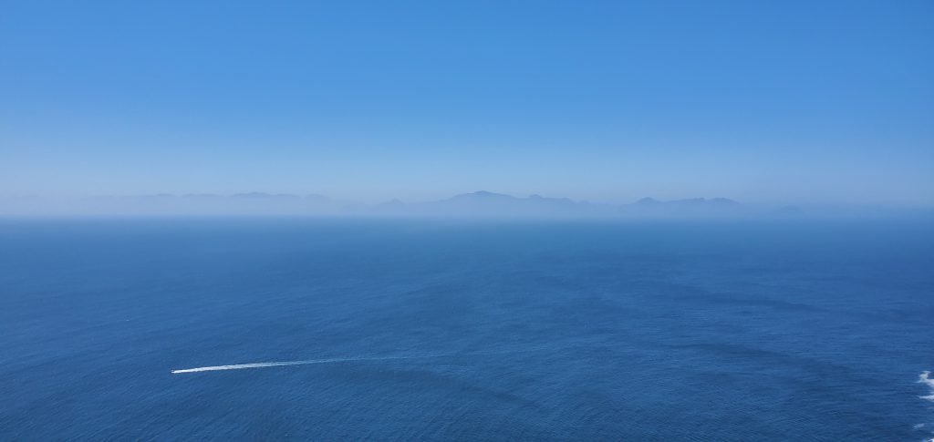 Blue Atlantic Ocean and Mountains in the backdrop