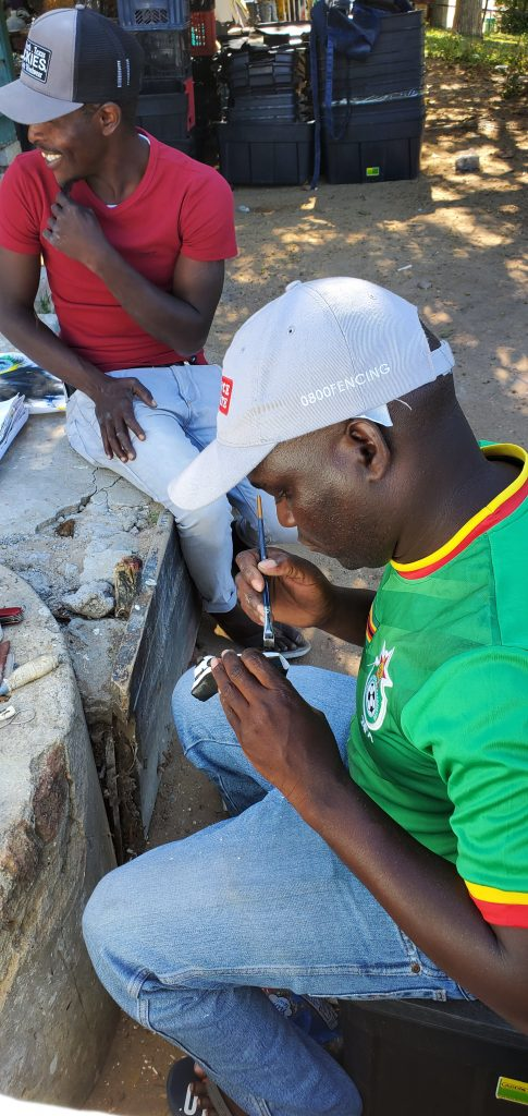 A local artist painting a Guineafowl,