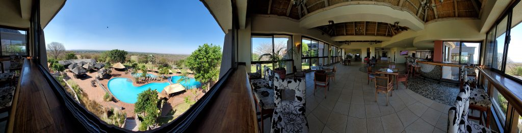 A panoramic view of the Outdoor Pool and Indoor Bar with elaborate sitting area.