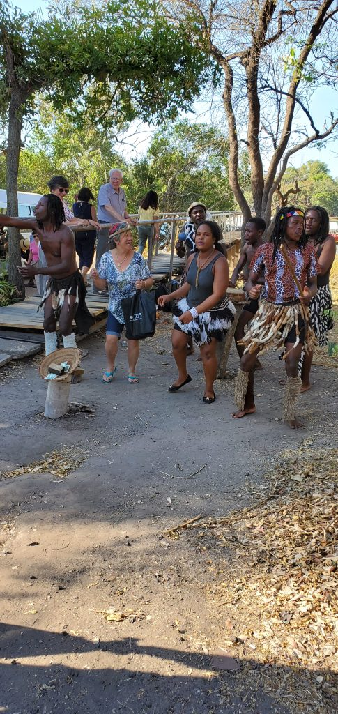 Welcome dance with the locals while onboarding the boat.
