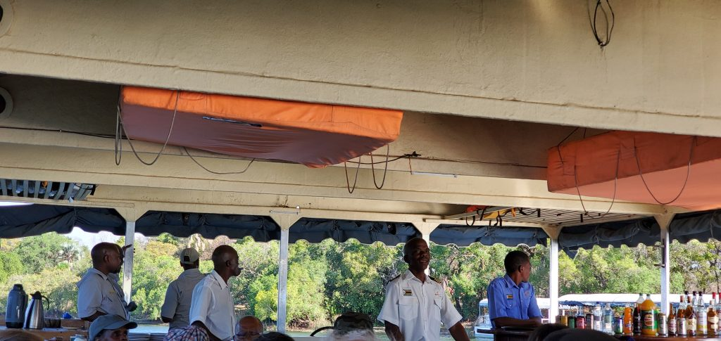 The Boat Captain and his trusted stewards on board to guide the boat and serve us well.