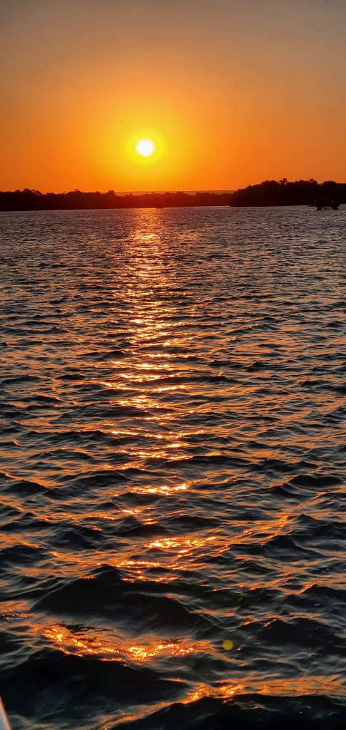 The majestic sunset colors sparkling on the water.